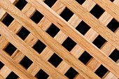 stock photo of wooden fence  - Spruce Square Wooden Timber Lattice Panel Fence Texture Pattern - JPG