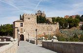 The alcazar above the medieval San Martin bridge - Toledo Spain