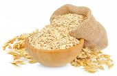 stock photo of oats  - oat flakes in a wooden bowl isolated on white - JPG
