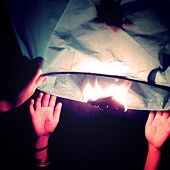Hands Holding Floating Lantern - Vintage Effect.