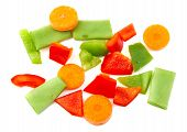 Chopped vegetables. Red, green pepper, carrot and beans on white background.