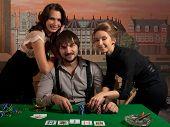People happy winning at poker.