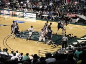 Nevada Vs. Hawaii: Uh Player Drives To The Basket As His Teammate Runs A Screen