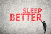 Asian businessman write text on wall, Sleep Better