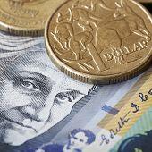 Australian money.  One dollar coin with kangaroos, over face of Edith Cowan.