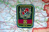 Illustrative editorial.Border guard of Ukraine in Lugansk region chevron.With map of Lugansk. Lost Eastern border of Ukraine.At January 10,2015 in Kiev, Ukraine