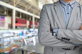 Business Man Standing In Front Of Blur Background Of Restaurant As Catering Or Food Service Business
