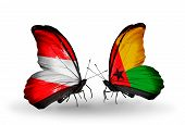 Two Butterflies With Flags On Wings As Symbol Of Relations Austria And Guinea Bissau