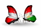 Two Butterflies With Flags On Wings As Symbol Of Relations Austria And Tajikistan