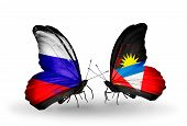Two Butterflies With Flags On Wings As Symbol Of Relations Russia And Antigua And Barbuda