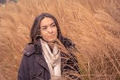 Young Beautiful Girl Posing In A Dry Grass Field