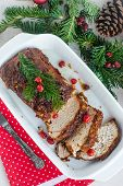 Roasted Pork Loin With Cherries And Spices On Celebratory Table
