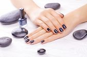 black manicure with black stones