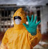 Scientist with protective yellow hazmat suit, ebola concept.