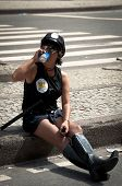 Woman in police uniform drinking beer