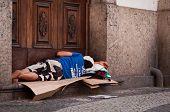 Homeless man sleeping at the church entrance