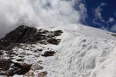 Mountain climbing in the snow on Marmolada, Dolomites