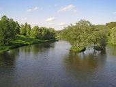 stock photo of spring-weather  - Two islands with trees in the middle of the river - JPG