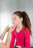 picture of throat  - Woman doctor examines a young girl - JPG