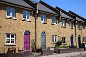 stock photo of suburban city  - Modern new terraced houses in Docklands - JPG