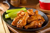 pic of chicken wings  - A plate of delicious Buffalo style chicken wings with celery and dipping sauce - JPG