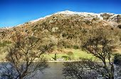 image of scars  - View of a snow capped Nab Scar across Rydal Water in the English Lake District - JPG