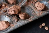 stock photo of truffle  - Chocolate truffles in an unusual shape with metal cutlery - JPG