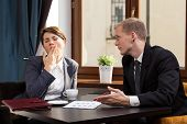 foto of yawn  - Businesswoman yawning during meeting in the cafe - JPG