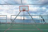 stock photo of atlantic ocean  - Basketball court and hoop with a view of the Atlantic ocean - JPG