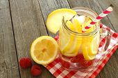 picture of mason  - Detox water with lemon and raspberries in a mason jar with straw - JPG