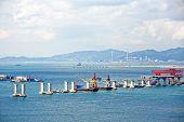 foto of hong kong bridge  - construction site of Hong Kong Zhuhai Macau Macao Bridge at day - JPG