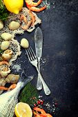 picture of saltwater fish  - Delicious fresh fish and seafood on dark vintage background - JPG