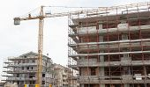 image of scaffolding  - Residential building construction site with scaffolding and crane - JPG