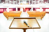 pic of church interior  - Blurred interior view of a modern church with empty pews - JPG