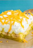 stock photo of jello  - Hawaiian salad made with lemon jello pineapple banana mini marshmallows topped with whipped cream and cheddar cheese - JPG