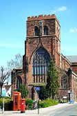 stock photo of church-of-england  - View of the Abbey Church of Saint Peter and Saint Paul with an old post box and telephone box in the foreground Shrewsbury Shropshire England UK Western Europe - JPG