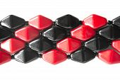 picture of beads  - Red and black glass beads on white as a background - JPG