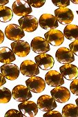 foto of beads  - Yellow amber beads on white as a background - JPG