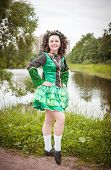 picture of cross-dress  - Young beautiful girl in irish dance dress and wig posing outdoor - JPG