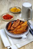 image of pot roast  - Roasted potatoes with spices in ceramic pot and beer in beer mug - JPG