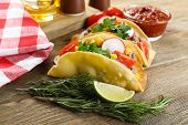 stock photo of tacos  - Mexican food Tacos on wooden table - JPG