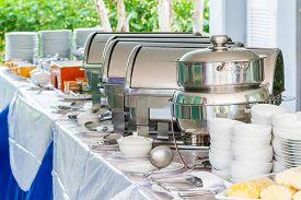 image of chafing  - Many buffet trays ready for service made of stainless steel at buffet - JPG