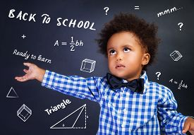 image of schoolboys  - Portrait of smart curly African American schoolboy in the school on math lesson - JPG