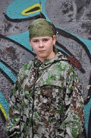 picture of paintball  - boy teenager in camouflage and with equipment for paintball - JPG