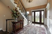 pic of entryway  - Foyer in suburban home with leaded glass doors - JPG
