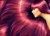 Beautiful Hair. Beauty woman with luxurious long red hair as background. Beauty Model girl with Heal poster