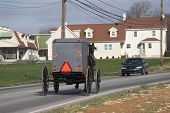foto of mennonite  - amish cart and car passing each other in pennsylvania dutch country - JPG