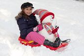 Girl With Toboggan And Snowman