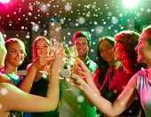 new year party, holidays, celebration, nightlife and people concept - smiling friends with glasses o poster