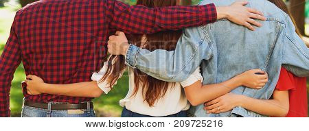 poster of Best friends forever. Group of happy young unrecognizable man and woman hugging together and talking on city street from back. Happiness, leisure, friendship, teamwork, family travels concept